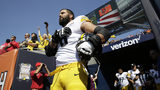 Pittsburgh Steelers offensive tackle and former Army Ranger Alejandro Villanueva (78) stands outside the tunnel alone during the national anthem before an NFL football game against the Chicago Bears, Sunday, in Chicago. (AP Photo/Nam Y. Huh)