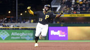 Pittsburgh Pirates' Andrew McCutchen celebrates as he heads to third base after hitting his first career grand-slam home run in the second inning of the baseball game against the Baltimore Orioles on Tuesday, Sept. 26, 2017. (AP Photo/Keith Srakocic)