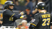 Pittsburgh Pirates' Josh Bell (55) celebrates with David Freese (23) after hitting a two-run home run during the third inning of a baseball game against the Baltimore Orioles, Wednesday, Sept. 27, 2017, in Pittsburgh. (AP Photo/Keith Srakocic)