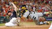 Washington Nationals' Daniel Murphy is tagged out at home by Pittsburgh Pirates catcher Elias Diaz, right, during the first inning of a baseball game, Friday, Sept. 29, 2017, in Washington. (AP Photo/Nick Wass)