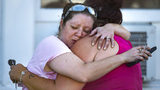 Carrie Matula embraces a woman after a fatal shooting at the First Baptist Church in Sutherland Springs, Texas, on Sunday, Nov. 5, 2017. (Nick Wagner/Austin American-Statesman via AP)