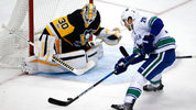 Vancouver Canucks' Brandon Sutter (20) can't get off a shot in front of Pittsburgh Penguins goalie Matt Murray (30) during the first period of an NHL hockey game in Pittsburgh, Wednesday, Nov. 22, 2017. (AP Photo/Gene J. Puskar)