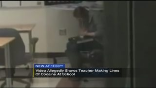Video appears to show high school teacher making lines of powdery…