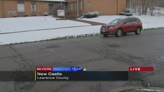 Snow moves through New Castle