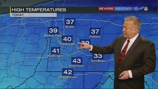 Snow showers tapering off; warmup expected Saturday