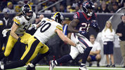 Houston Texans running back Lamar Miller (26) rushes as Pittsburgh Steelers outside linebacker T.J. Watt (90) defends during the second half of an NFL football game Monday, Dec. 25, 2017, in Houston. (AP Photo/Eric Christian Smith)