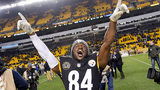 FILE - In this Dec. 11, 2017, file photo, Pittsburgh Steelers wide receiver Antonio Brown (84) celebrates a 39-38 win over the Baltimore Ravens in an NFL football game in Pittsburgh. (AP Photo/Don Wright)