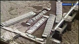 Officials unsure when loose barges will be removed, dam will reopen