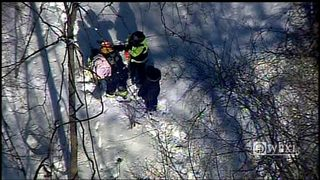 RAW VIDEO: Woman and dog rescued from hillside