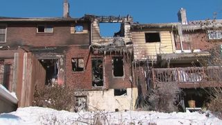 Fire burns through row houses as street turns to ice