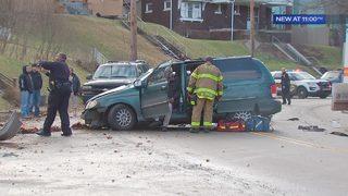 5 injured after minivan hits telephone poles