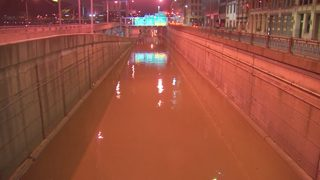Flooding closes Downtown roads, riverwalks