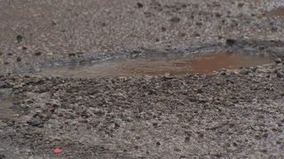 What is causing so many potholes to form this winter?