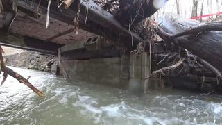 Residents ask for help after heavy rain washes out bridge, road
