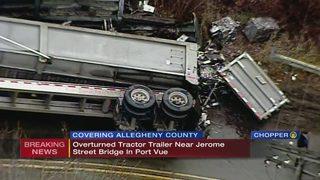 Tractor-trailer crashes, spills debris on road