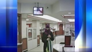 Police searching for man who held up bank while wearing dress