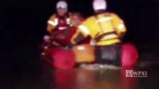 RAW VIDEO: Police officer rescued from floodwaters