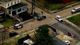 Homes struck during shootout between vehicles