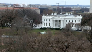 Woman taken into custody after crashing into White House barrier