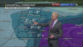 Snow moving through area early Wednesday morning