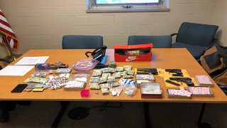 2 charged in heroin bust, 50 bricks seized