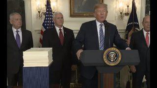 Trump backs off veto threat, signs giant federal spending bill