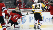Sidney Crosby scores the game winning goal in overtime against Keith Kinkaid of the New Jersey Devils at the Prudential Center on March 29, 2018 in Newark, New Jersey. (Photo by Bruce Bennett/Getty Images)