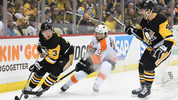 PITTSBURGH, PA - APRIL 11: Olli Maatta #3 of the Penguins looks to clear the puck under pressure from Scott Laughton #21 of the Flyers during the third period in Game One of the Eastern Conference First Round. (Photo by Justin Berl/Getty Images)