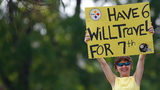A fan holds up a sign during the Pittsburgh Steelers training camp on July 29, 2011 at St Vincent College in Latrobe, Pennsylvania. (Photo by Jared Wickerham/Getty Images)