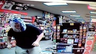 RAW VIDEO: Burglar uses water bottle wrapper as disguise