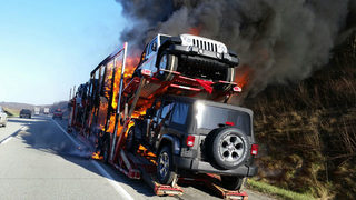 Tractor-trailer hauling Jeeps catches fire