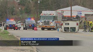 Van ends up on roof after crash, driver transported to hospital