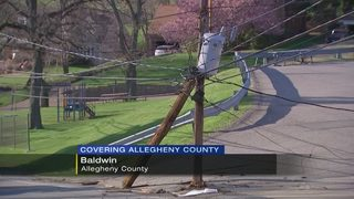 Street reopens after crash shears utility pole, downs wires