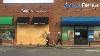 Cleanup continues after car goes into hair salon