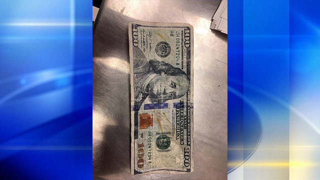 COUNTERFEIT MONEY: Police charge woman with distributing fake $100