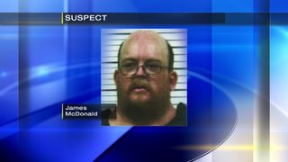 Man threw full bottles of liquid at passing cars, police say