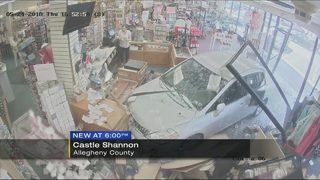 Video shows car crashing into Hallmark store