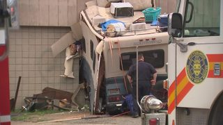 RV crashes into building; 3 people hurt