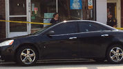 A car sits at a police scene in Carrick. (Photo by Chris Johnston/WPXI)