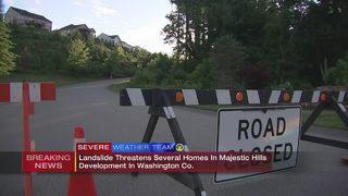 Moving hillside bringing trees down, threatening homes