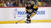 Phil Kessel #81 of the Pittsburgh Penguins controls the puck in Game Four of the Eastern Conference Second Round during the 2018 NHL Stanley Cup Playoffs against the Washington Capitals at PPG PAINTS Arena on May 3, 2018 in Pittsburgh, Pennsylvania.
