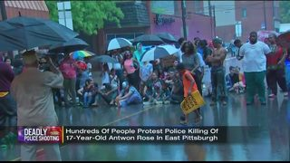 Hundreds of people protest police shooting local teen