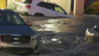RAW VIDEO: Flooding sweeps SUV through Bethel Park parking lot, rolls it over