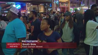 Protesters make their way down East Carson Street on the South Side