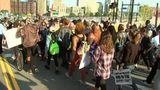 Protesters march through the Hill District to downtown Pittsburgh