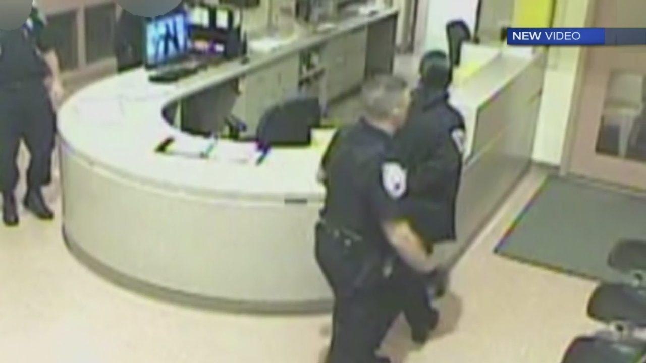 Police officer handcuffs jail guard at Washington County