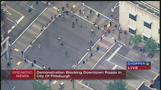 Protesters march through downtown Pittsburgh after blocking intersection