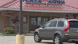 Employee charged with recording woman in restaurant bathroom