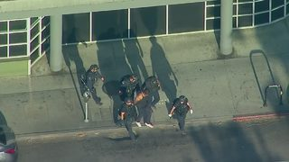 Details emerge in shooting, hostage situation in L.A.