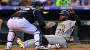 Gregory Polanco slides to home plate and scores on a fifth inning double and beats a tag attempt by Chris Iannetta during a game at Coors Field on August 7, 2018 in Denver, Colorado. (Photo by Dustin Bradford/Getty Images)